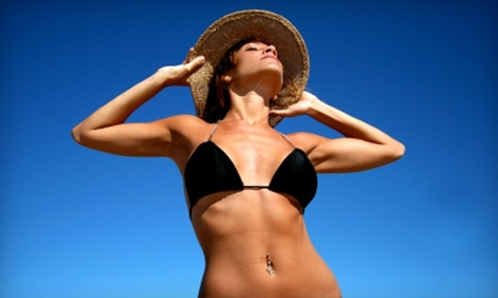 Miles Salon and Spray Tanning - Lexington-Fayette: $15 for Two Technician-Applied Spray Tans at Miles Salon and Spray Tanning ($30 Value)