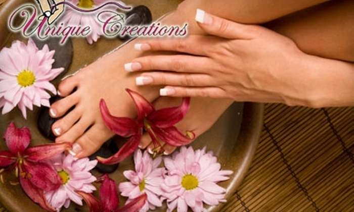 Unique Creations Therapeutic Day Spa - Broadmoor/Sherwood: $25 for a 30-Minute Manicure and 30-Minute Pedicure at Unique Creations Spa ($60 Value)