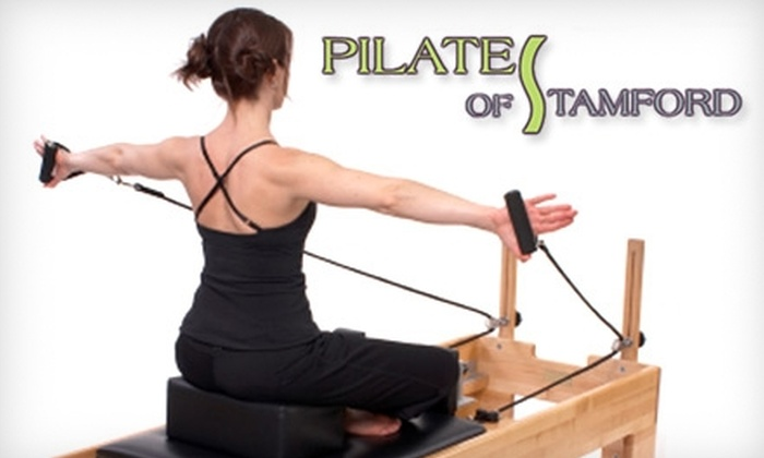 Pilates of Stamford - Newfield - Westover - Turn of River: $50 for Three Mat or BalleCore Classes Plus Two Group Reformer or Equipment Classes at Pilates of Stamford ($155 Value)