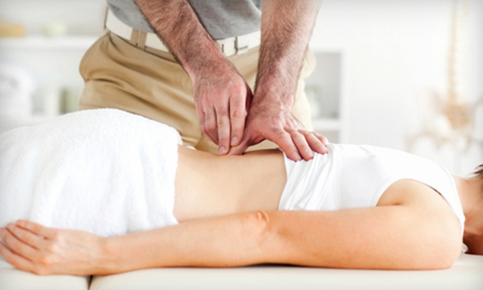 East Coast Chiropractic - Downtown Manchester: Chiropractic Exam and 60-Minute Massage with Optional X-rays and Adjustment at East Coast Chiropractic (Up to 82% Off)