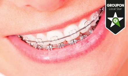 Clínica Médica Dentária Porto Centro — Baixa: aparelho dentário metálico ou estético e seis consultas desde 34,90€