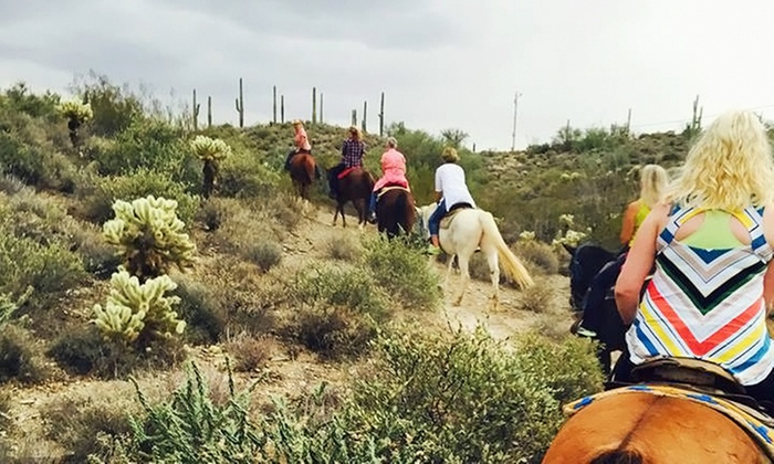 Spur Cross Stables - Cave Creek: 1.5-Hour Guided Horseback Ride for One, Two, or Four from Spur Cross Stables (Up to 49% Off)