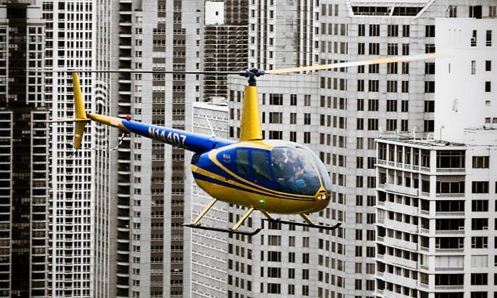 Sun Aero Helicopters Inc. - Lansing: 35-Minute Helicopter Tour of Chicago for Two or Three from Sun Aero Helicopters Inc. (Up to 46% Off)