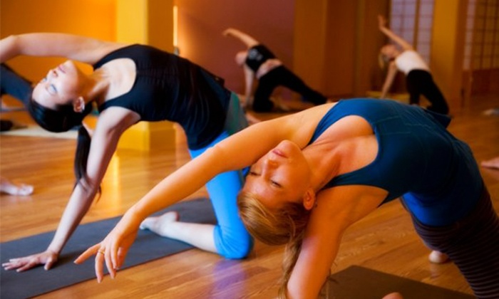 Dharma Yoga - West University: One Month of Unlimited Classes or 10-Class Pass at Dharma Yoga (Up to 67% Off)