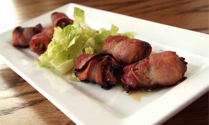 Common Ground - East Village: Pub Snacks with Drinks for Two, Four, or Six at Common Ground (Up to Half Off)