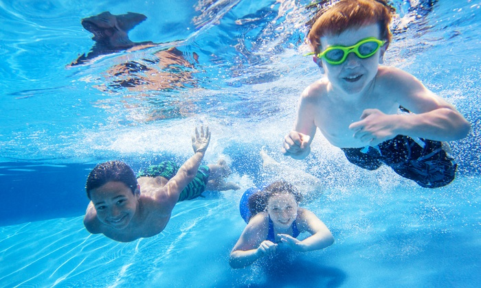 Mack Indoor Pool - Ann Arbor: Dive-In Movie Night Admission for a Family with 2 Adults and 2 Kids at Mack Indoor Pool (Up to 44% Off)