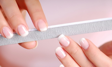 One or Three Martini Manicures with Drinks at Symmetry Beauty and Nail Bar (Up to 48% Off)