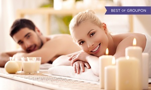 YOUNG FOREVER ESTHETIC CENTER: 60-Minute Couple's Massage with Optional Chocolate, Champagne, and Fruit (Up to 40% Off)
