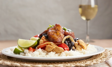 Caribbean Meal with a Glass of Wine for Two or Four at The Red Lion