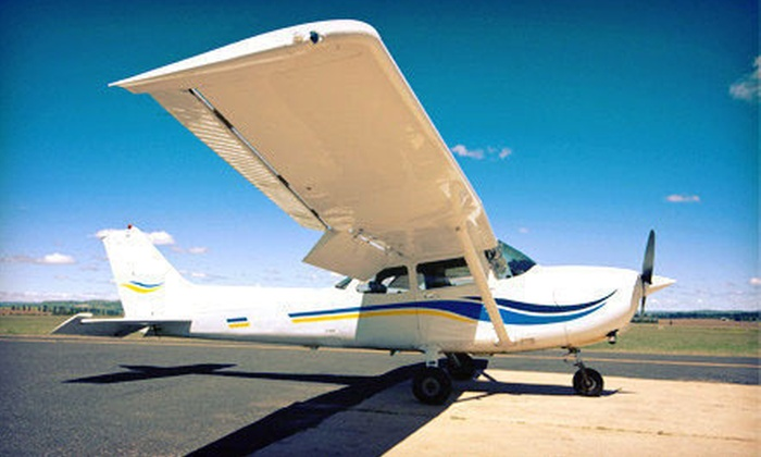 Danny Waizman Flight School And Aircraft Rental - East Farmingdale: Introductory Flight Lesson at Danny Waizman Flight School and Aircraft Rental (Up to 65% Off). Three Options Available.