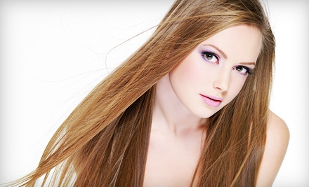 Feather Extensions, or Highlights in One or Two Colors or Set of Hair Extensions at Sandals Nail Spa (Up to 55% Off)