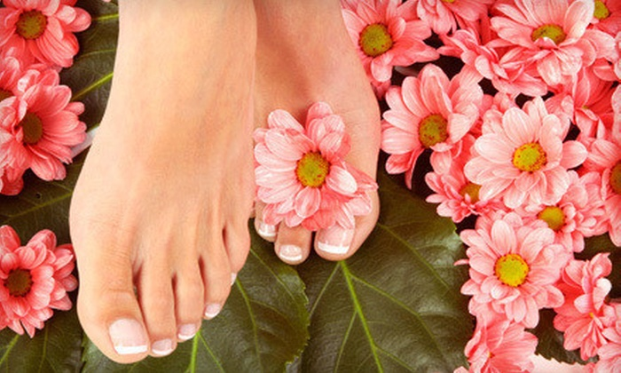 The Retreat Salon and Day Spa - Avery Road Retail Center: $37 for One-Hour Mani-Pedi Package at The Retreat Salon and Day Spa ($75 Value)