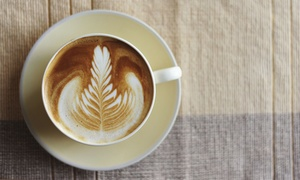 Veloce Espresso: Four Coffee Drinks or Two Panini Sandwiches at Veloce Espresso (Up to 57% Off)