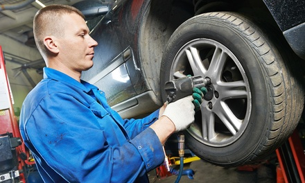 Two or Four Wheel Alignment with Tire Rotation and Brake Inspection at Tucker Auto Service Inc. (Up to 64% Off)