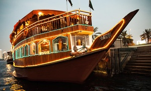 Mala Tours: Dinner Cruise on a Traditional Wooden Dhow from AED 75 at Oasis Palm Floating Restaurant (Up to 52% Off)
