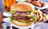 Green Parrot Pub - Carrollwood: Two or Four Burgers with Fries and Beer, or $12 for $20 Worth of Food at Green Parrot Pub