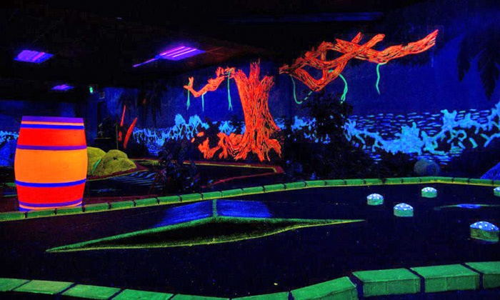 Wonderland Family Fun Center - Spokane: $21.99 for a Large Pizza and Black-Light Mini Golf for Four at Wonderland Family Fun Center (Up to $47.95 Value)