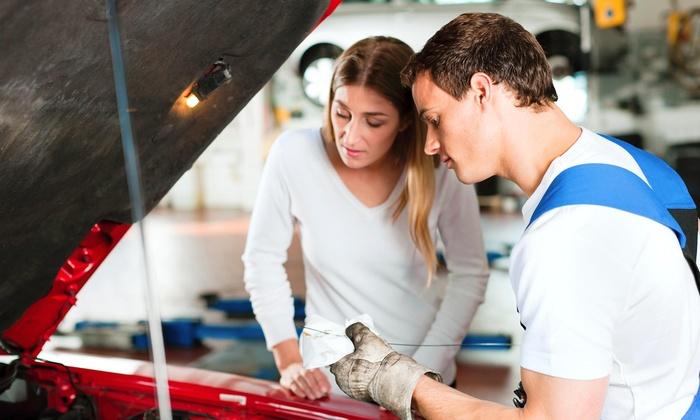 Adams Muffler & Auto Repair - Moorpark: Full-Service Oil Change with Tire Rotation and Brake Inspection at Adams Muffler & Auto Repair (55% Off)