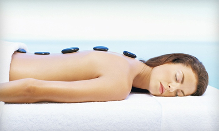 Touch of Class Day Spa - Coral Springs: $129 for Hot-Stone Massage, Foot Massage, Facial, and Body Wrap, Plus Wine at Touch of Class Day Spa (Up to $305 Value)