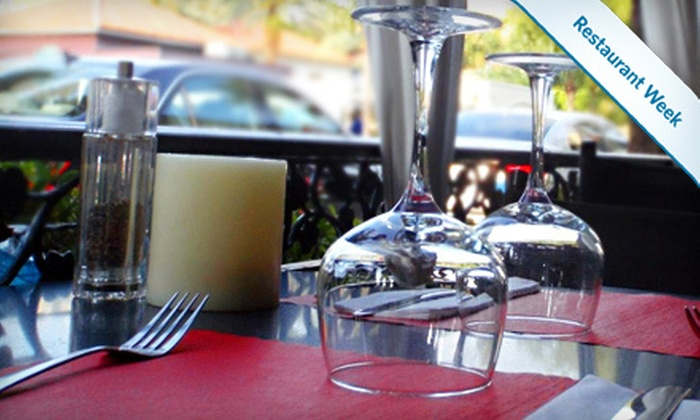 St. Tropez Bistro - Colee Hammock: $39 for a French Dinner for Two with Appetizer, Entrees, and Dessert at St. Tropez Bistro (Up to $81 Value)