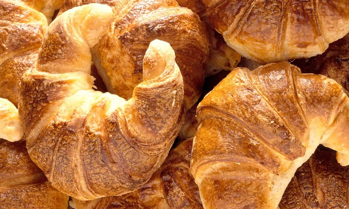 Le Parisien Cafe - Multiple Locations: $11 for Two Groupons, Each Good for $10 Worth of French Cuisine at Le Parisien Cafe ($20 Total Value)