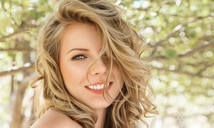 Infiniti's Hair Salon and Spa - Colorado Springs: $55 for Haircut Package with Color or Highlights at Infiniti's Hair Salon and Spa ($112 Value)