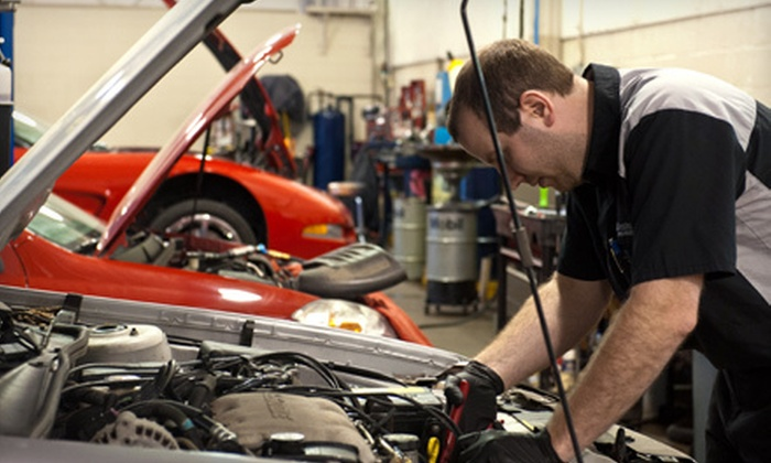 Bill Estes Chevrolet - College Park: Oil Change, Alignment Check with Tire Rotation, AC Service, or Complete Showroom Detail at Bill Estes Chevrolet (Up to 62% Off)