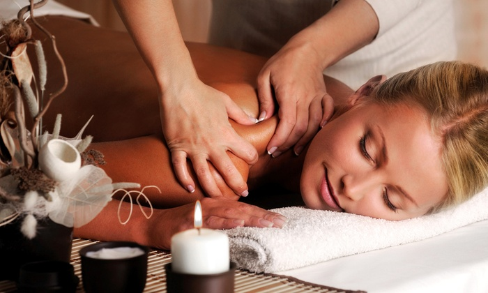 Yossi Salon and Spa - Boynton Beach: $40 for One 50-Minute Kombi Blend or Aromatherapy Massage at Yossi Salon and Spa ($80 Value)