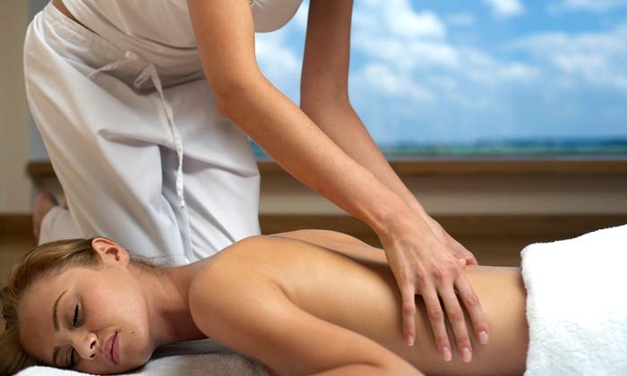 T Kemp @ Living Wellness - Northfield: $38 for a Deep-Tissue or Trigger-Point Massage from T Kemp @ Living Wellness ($75 Value)