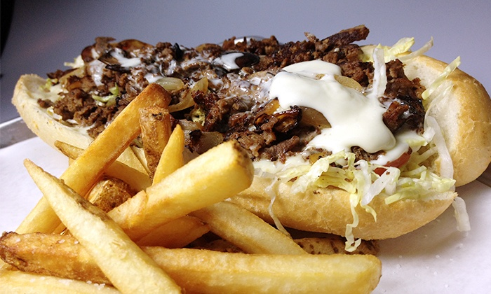 Monti's - Lincoln Square: 8-in Authentic Philly Cheesesteak with Fries or Salad, Dessert, and Beer for 2 or 4 at Monti's (Up to 51% Off)