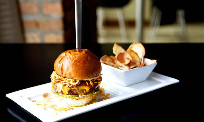 The Grid - River North: Comfort Food Meal for 2 or 4, Brunch for 2, or Bottle Service and Food for Up to 12 at The Grid (Up to 50% Off)