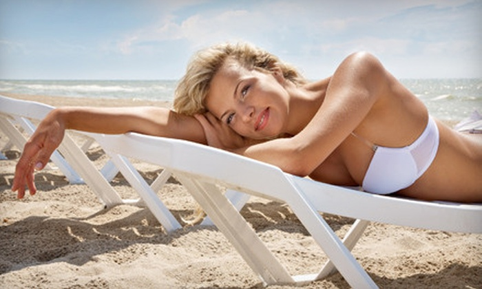 Xotic Tan & Sun Spa - Fort Worth: Airbrush or Tanning-Bed Packages at Xotic Tan & Sun Spa (Up to 76% Off)
