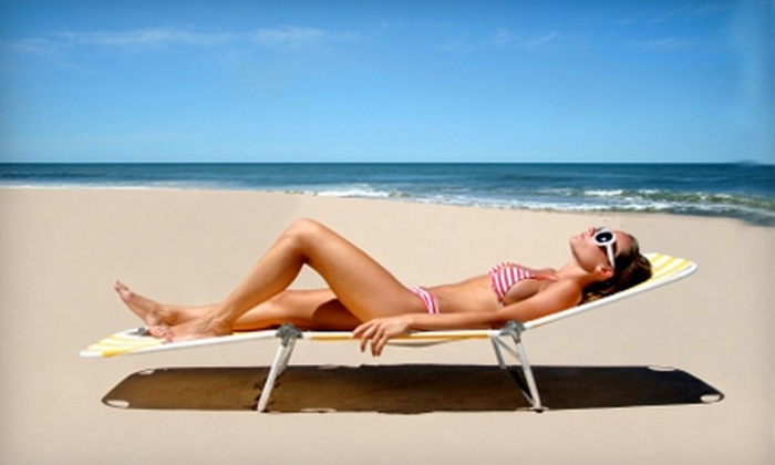 Glisten Sunless Tanning - Sterling Farms: $44 for Three Airbrush Tanning Sessions with Prep Spray and After Spray at Glisten Sunless Tanning ($88 Value)