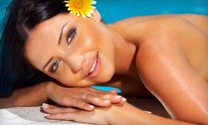 In Bloom Tanning - Sunnyside: 30 Days of Unlimited Bed Tanning or Three Spray-Tan Sessions at In Bloom Tanning in Sunnyside