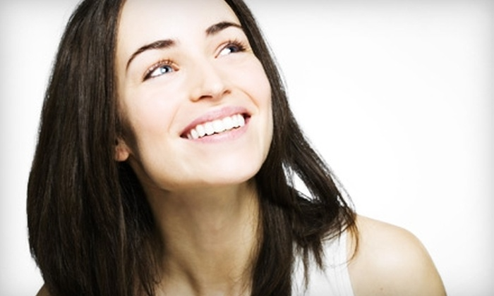 Signature Smiles - Multiple Locations: $50 for Dental Exam, X-rays, and a Cleaning at Signature Smiles ($316 Value)