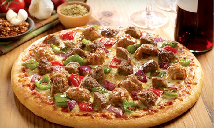 Boston's - Robertson: $15 for $30 Worth of Pizza and Pub Fare at Boston's in Manchester