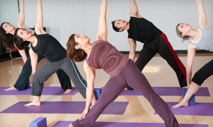 East West Fitness World - Emerson Garfield: $25 for a One-Hour Private Pilates Session ($50 Value) or $25 for One Month of Unlimited Fitness Classes ($159 Value) at East West Fitness World