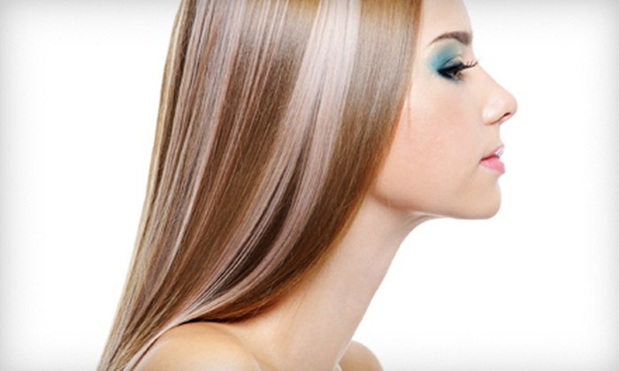 Nolas Salon - Summerville: Haircut Package with Blowout and Wine or Keratin Hair Treatment at Nolas Salon in Summerville (Up to 55% Off)