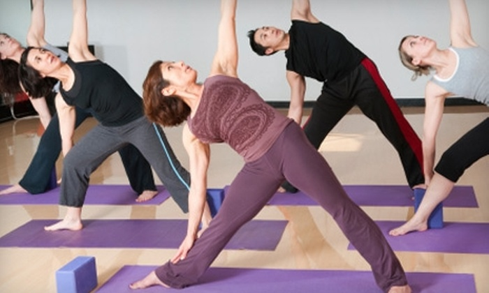 Absolute Yoga & Wellness - Multiple Locations: $25 for Five Classes at Absolute Yoga & Wellness ($75 Value)