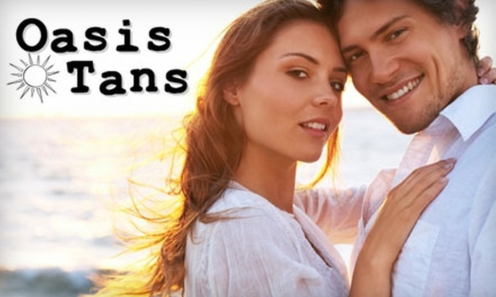 Oasis Tans - Orlando: $15 for Either One Custom Airbrush Tan or Five Bed Sessions at Oasis Tans (Up to $40 Value)