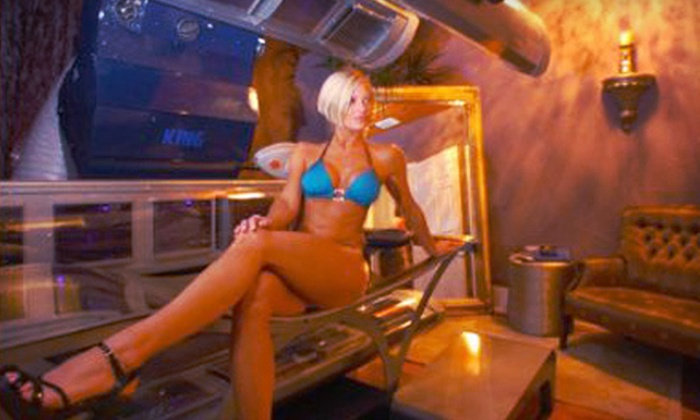Tan Lounge - Multiple Locations: One Month of UV Tanning or Five Spray-Tanning Sessions at Tan Lounge (Up to 74% Off)