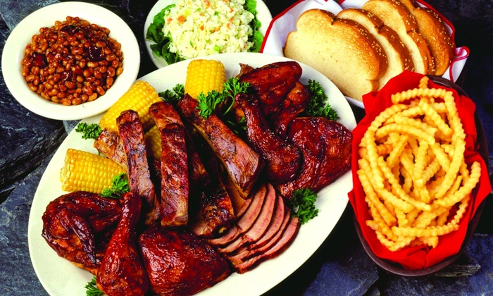 Woody's Bar-B-Q - Ogden: $18 for Two Groupons, Each Good for $16 Worth of Barbecue Food at Woody's Bar-B-Q ($32 Value)