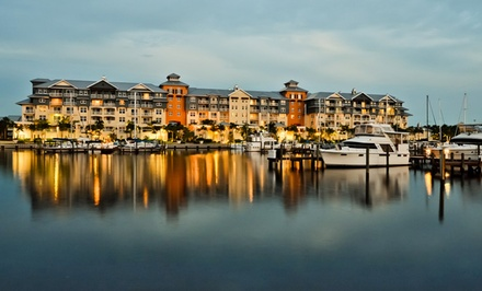 groupon daily deal - Stay at Harborside Suites at Little Harbor in Greater Tampa Bay, FL. Dates into August.