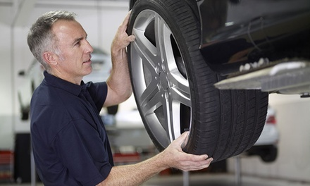 Brake Pad Replacement: Front or Rear ($99) or Both with Skimming ($249) at Adams Motors Services (Up to $500 Value)