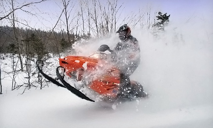 Northeast Snowmobile Rentals - Fryeburg: Four-Hour Snowmobile Rental for Two at Northeast Snowmobile Rentals (Up to Half Off). Four Options Available.