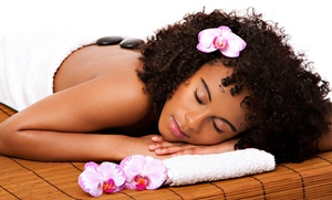 Designz By Candice: One 60-Minute Hot-Stone Massage, One European Facial, or Both at Designz By Candice (Up to 56% Off)