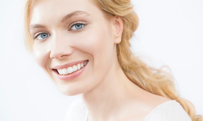 RadiantFX - Midtown: Take-Home Teeth-Whitening Set or In-Office Whitening with Touch-Up Set at RadiantFX (Up to 75% Off)