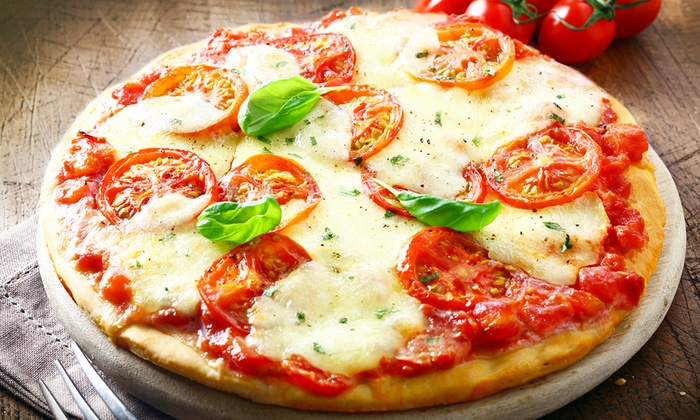 Topp N Pie - Orlando - Waterford Towers: $10 for $18 Worth of Fast and Fresh Pizza for Two or More at Topp N Pie - Orlando