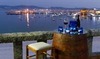 Menú para 2 o 4 con surtido de entrantes, principal, surtido de postres, botella de vino y café desde 29,95 € en Fidel