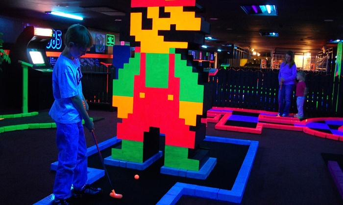 The Family Fun Center XL - South Central Omaha: 18 Holes of Glow Golf for Up to Five or Eight at The Family Fun Center XL (Up to 52% Off)